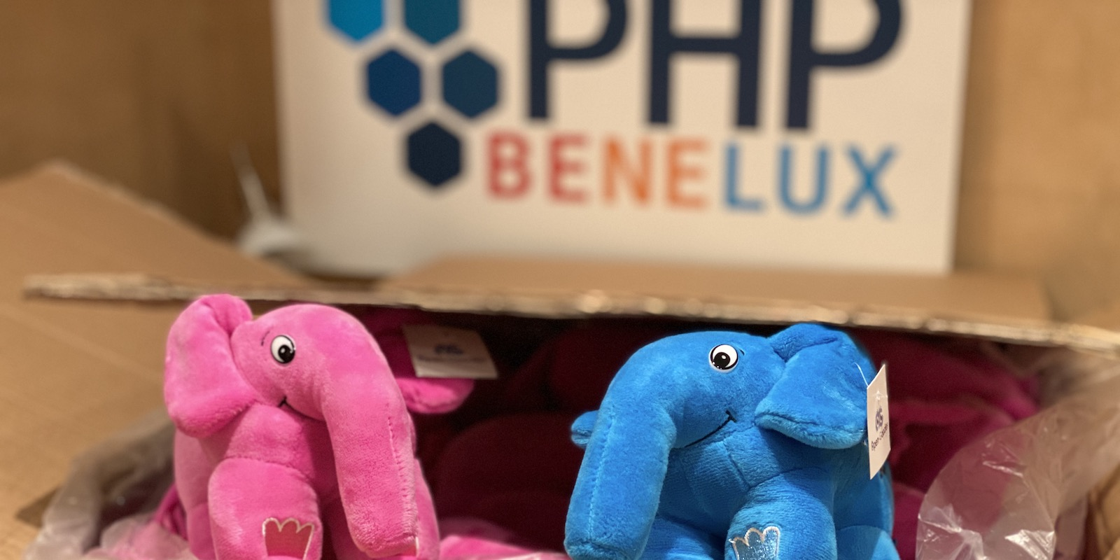 PHP mascot elephant in front of PHPBenelux sign